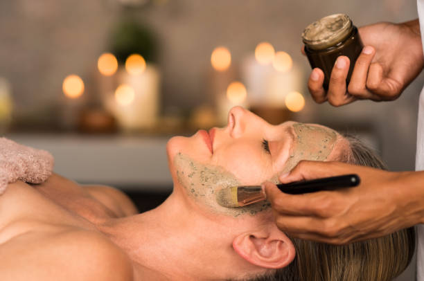 woman with clay mask on face - face mask stock pictures, royalty-free photos & images