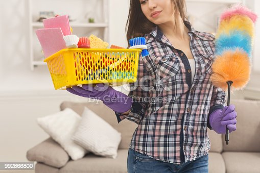 istock Woman with cleaning equipment ready to clean room 992866800