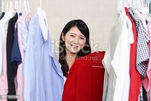 istock Woman with clothes 637592594