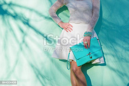istock Woman with clutch bag 844004406
