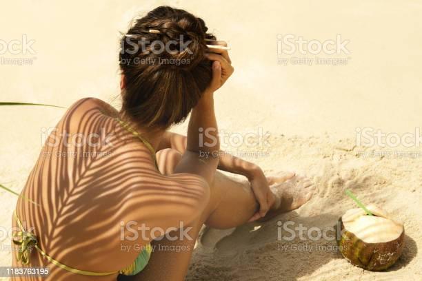 Woman with coconut drink under palm leaf picture id1183763195?b=1&k=6&m=1183763195&s=612x612&h=urbxwmpiv8xgfyvkyou8ba9e0rhqow ws5bputsxvvo=