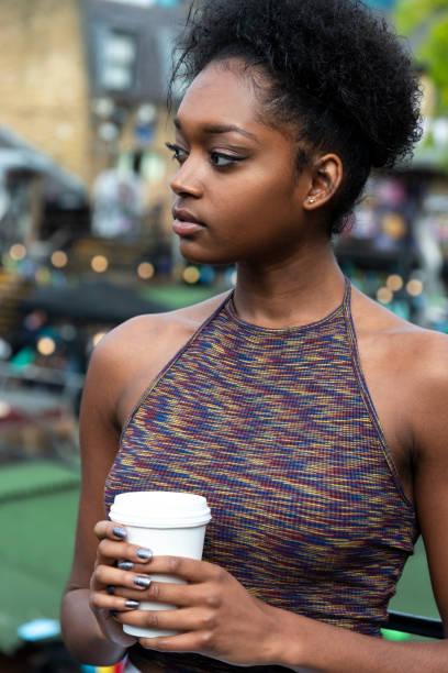 Woman with Coffee in Camden Lock area, London, UK stock photo