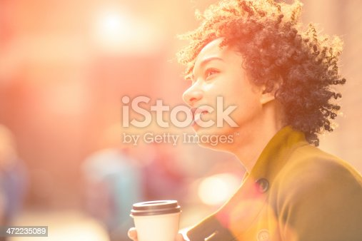 Beautiful woman enjoying coffe outdoors on a sunny autumn day.
