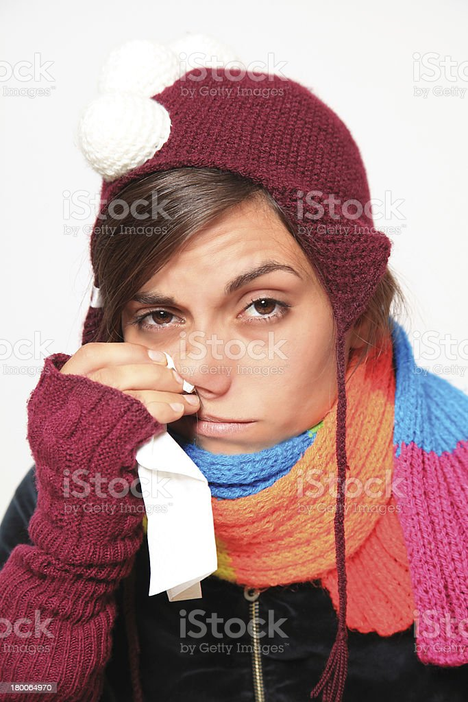 Woman with cold wearing knitted hat scarf and gloves royalty-free stock photo