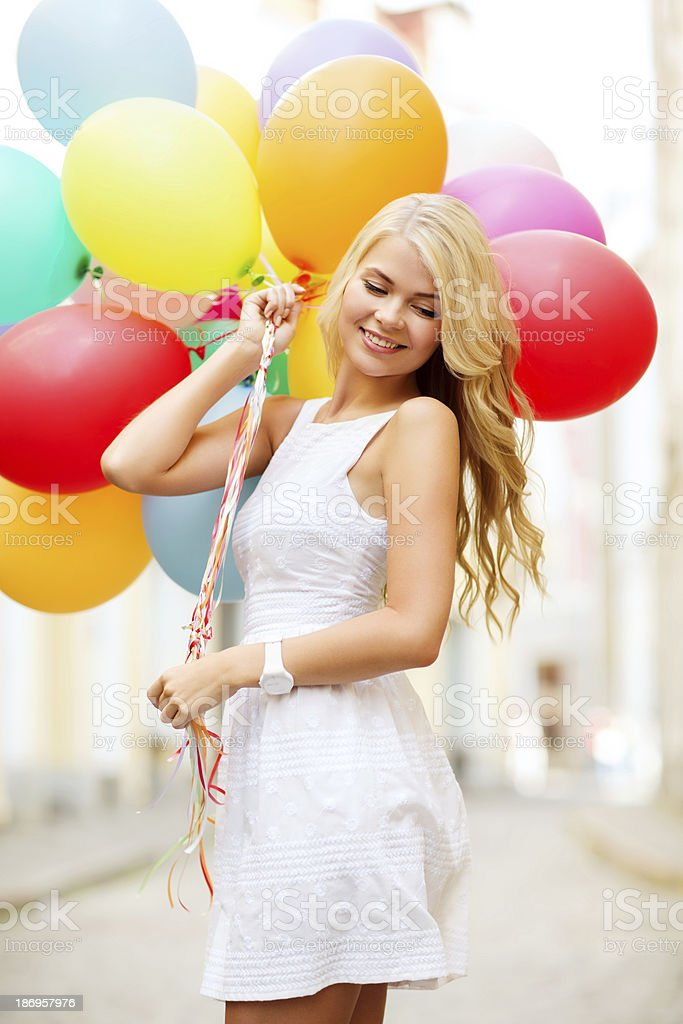 woman with colorful balloons royalty-free stock photo