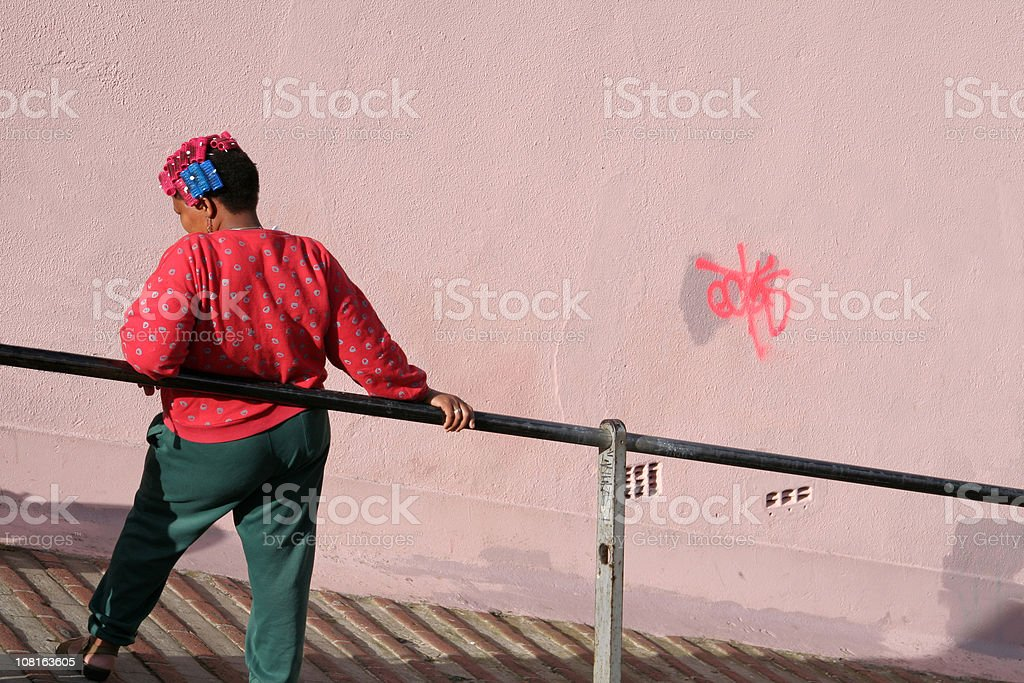 Woman with colorful curlers relaxing  in Cape town, South Africa stock photo