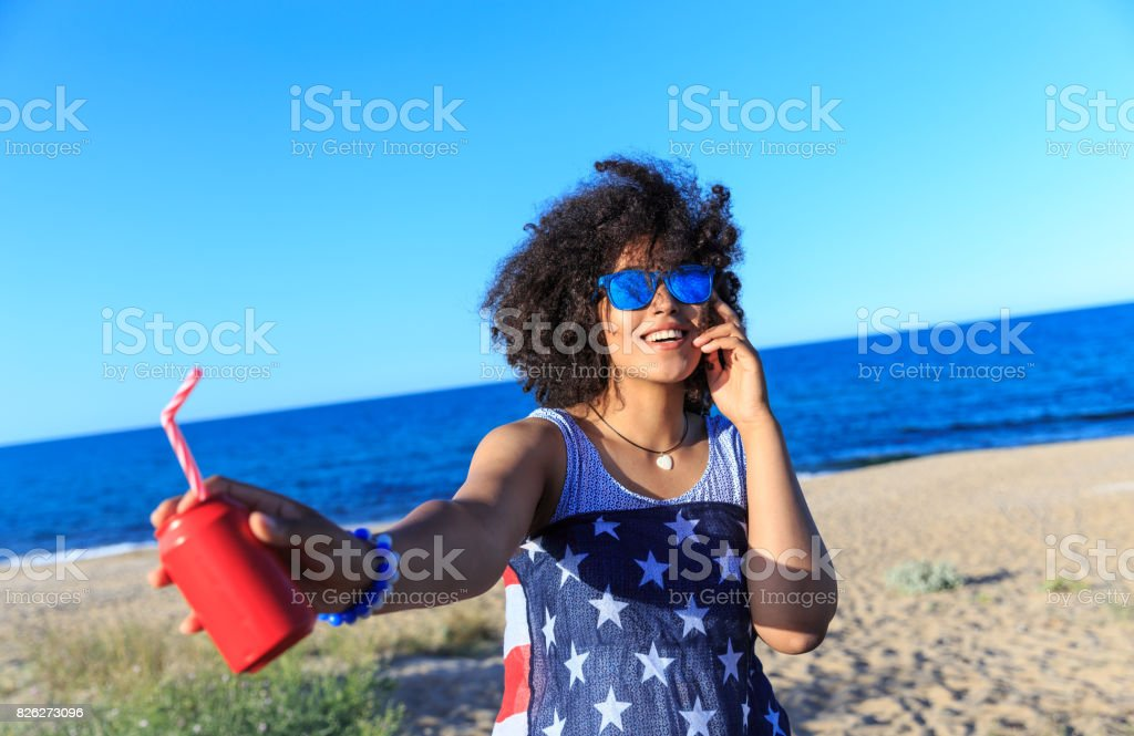 Woman with colorful sunglasses riding on sand stock photo