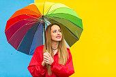 istock Woman with colorful umbrella having fun in rainy day 1182945002