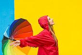 istock Woman with colorful umbrella having fun in rainy day 1198028639