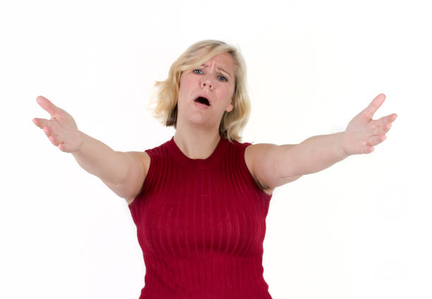 woman with compassionate face and arms outstretched stock photo