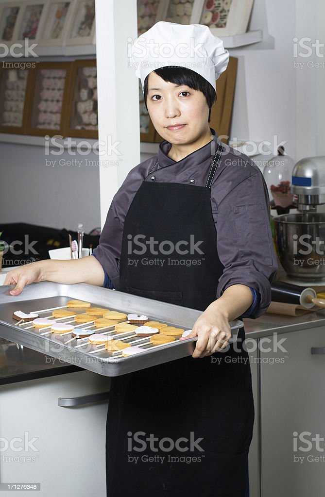 Woman with cookie stock photo