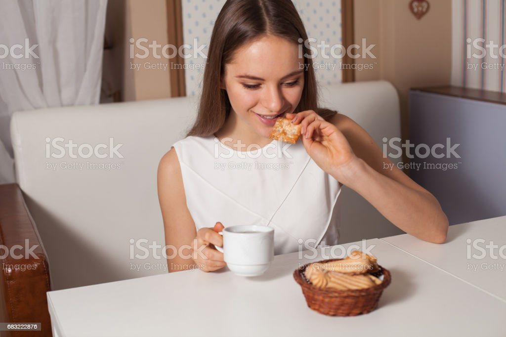 Woman with cookies and tea 免版稅 stock photo