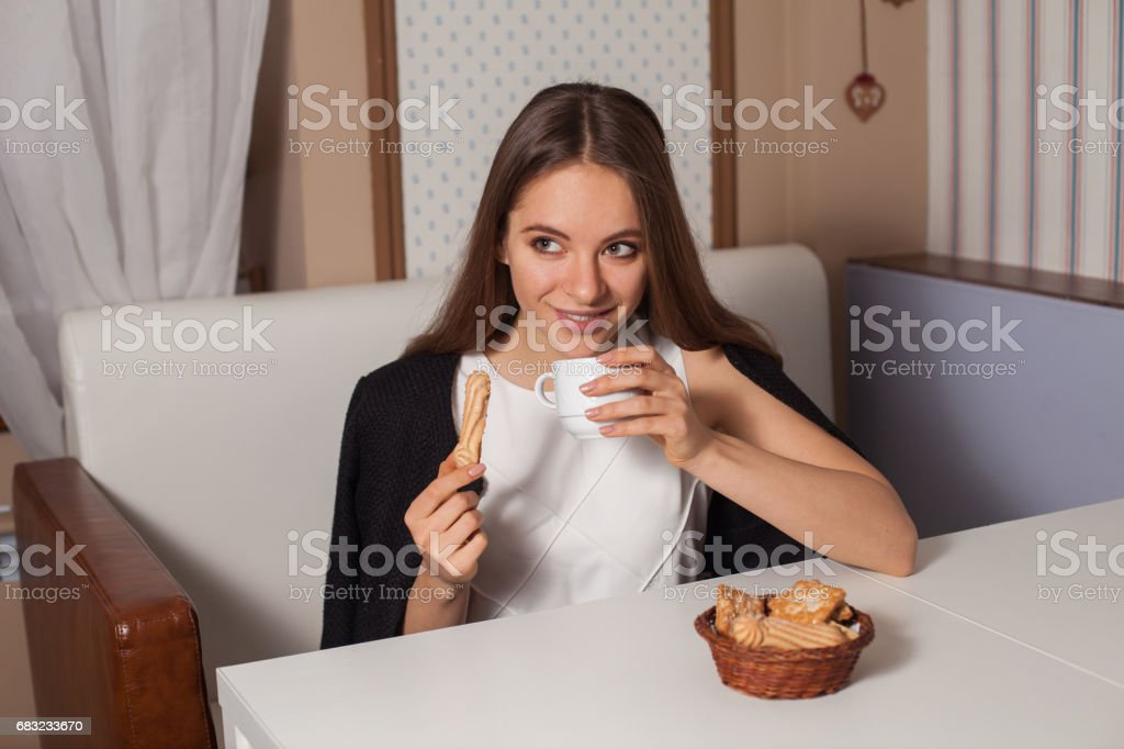 Woman with cookies and tea royalty-free 스톡 사진