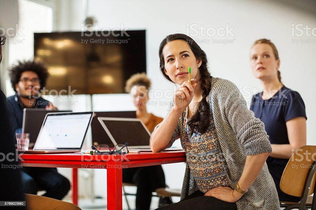 Woman with coworkers in conference room stock photo
