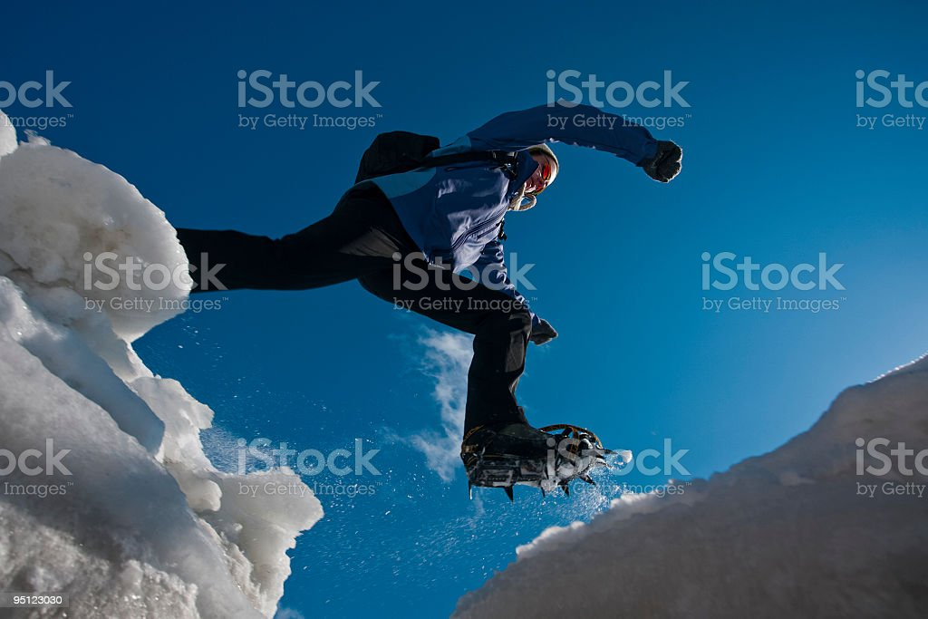 Woman with crampons jumping. royalty-free stock photo