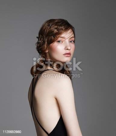 Portrait of young beautiful woman with hair clips and pins