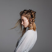 Portrait of young beautiful woman with braids
