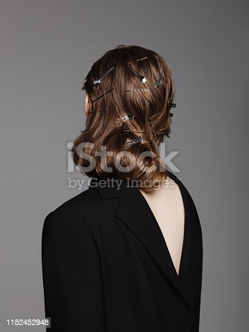 Rear view of woman with hair clips and pins