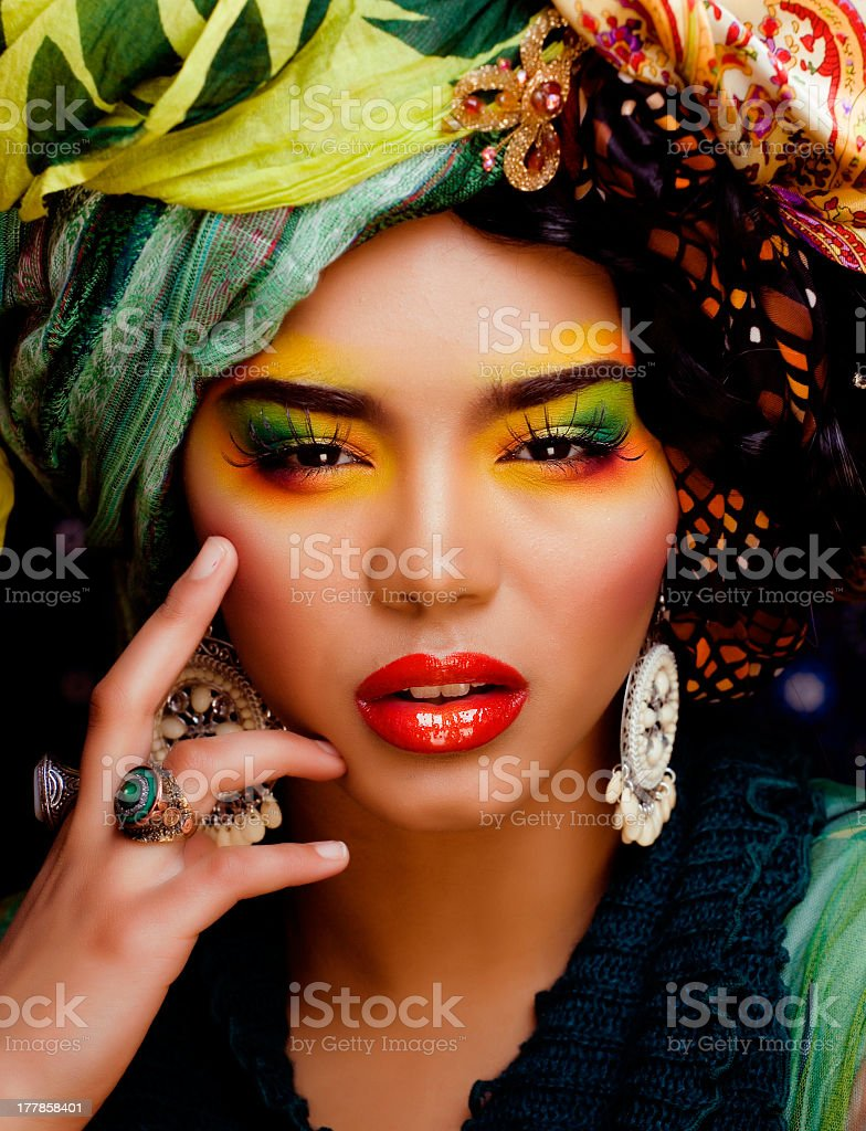 woman with creative make up, many shawls on head royalty-free stock photo