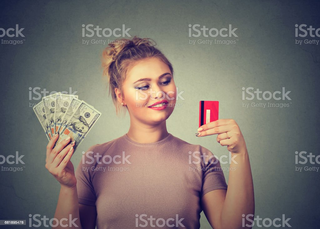 Woman with credit card and dollar cash happy with bank choice stock photo