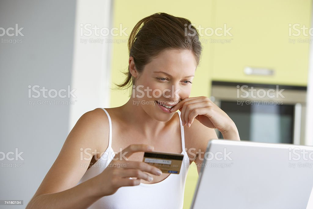 Woman with credit card at laptop royalty-free stock photo