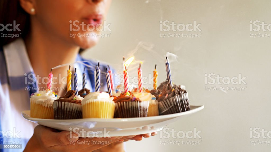 Woman with Cupcakes stock photo