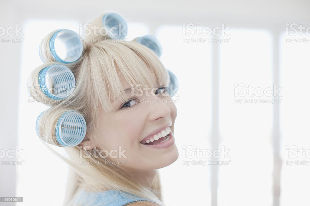 Woman with curlers in hair royalty-free stock photo