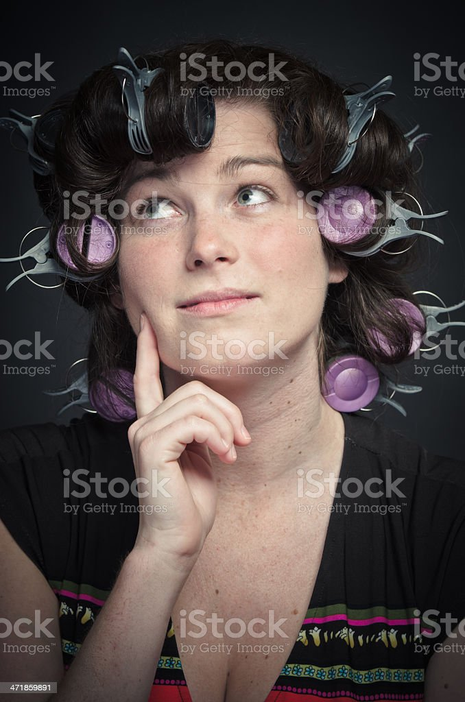 Woman with Curlers thinking royalty-free stock photo
