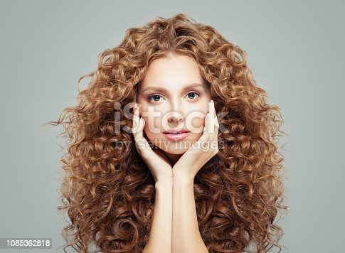 Woman with curly hair. Beautiful girl with healthy wavy hairstyle, haircare concept