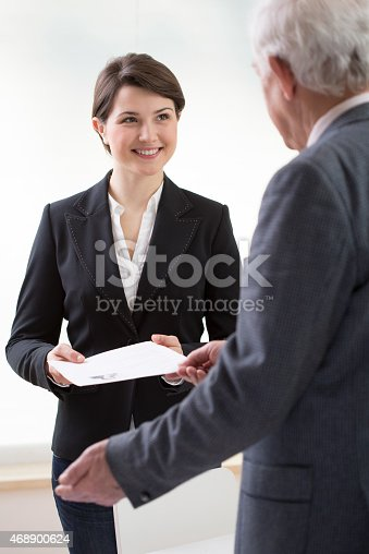 Young pretty woman on job interview with curriculum vitae