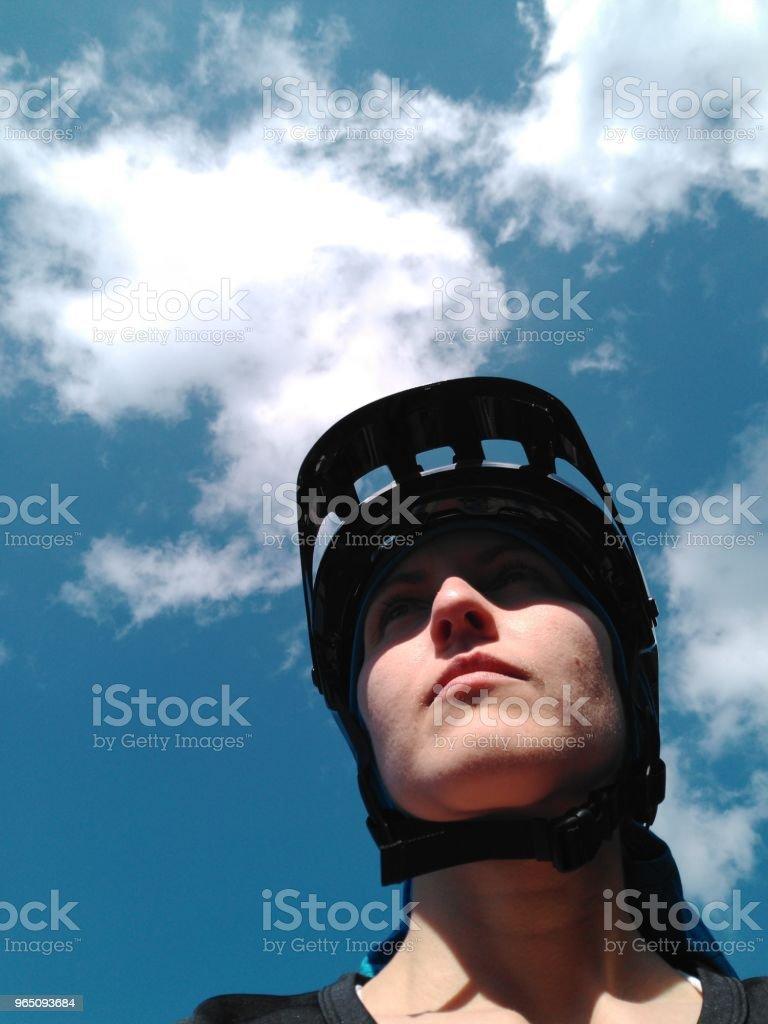 Woman with cycling helmet on her head. zbiór zdjęć royalty-free