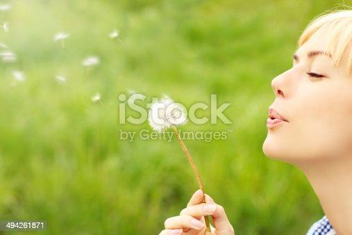 istock Woman with dandelion 494261871