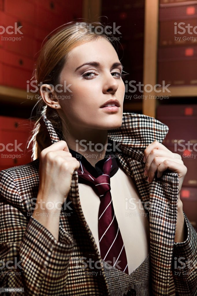 Woman with dandy style in a shoe store stock photo