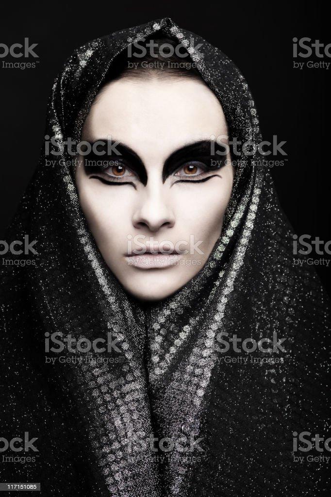 Woman with Dark Eye Makeup stock photo