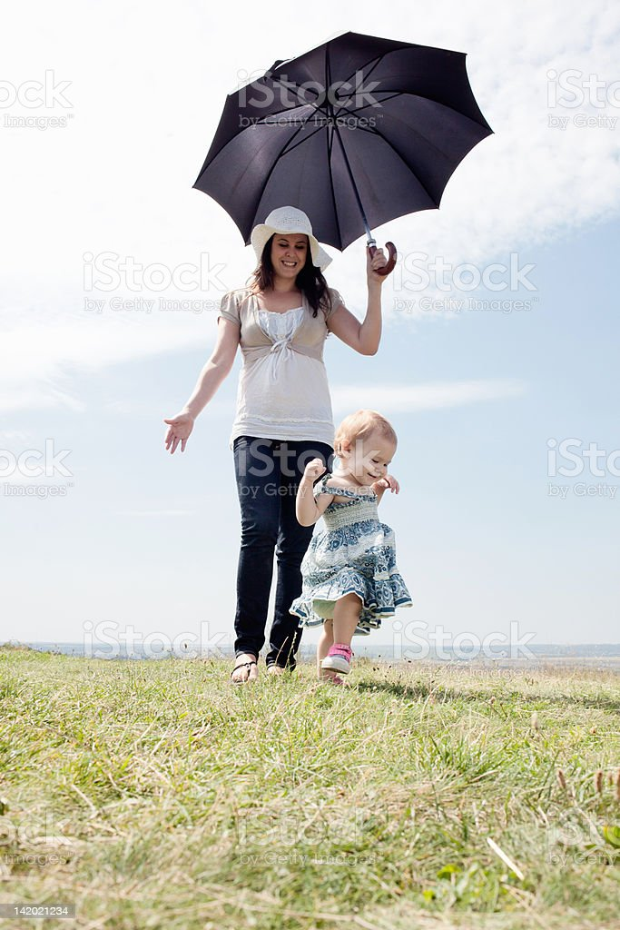 Woman with daughter and umbrella stock photo