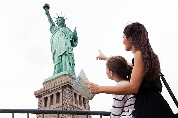 Woman with daughter traveling stock photo