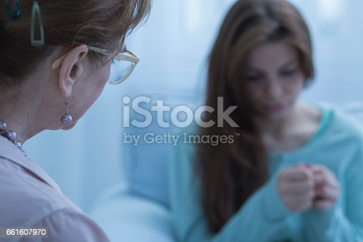 istock Woman with depression having help 661607970