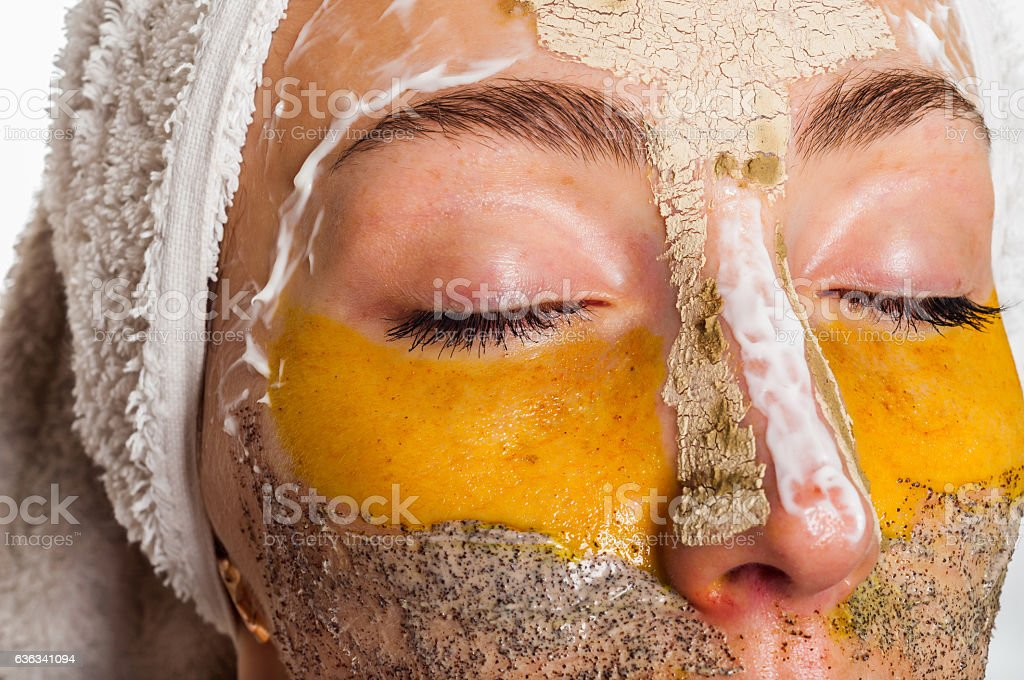 Woman with different masks on her face multi-masking stock photo