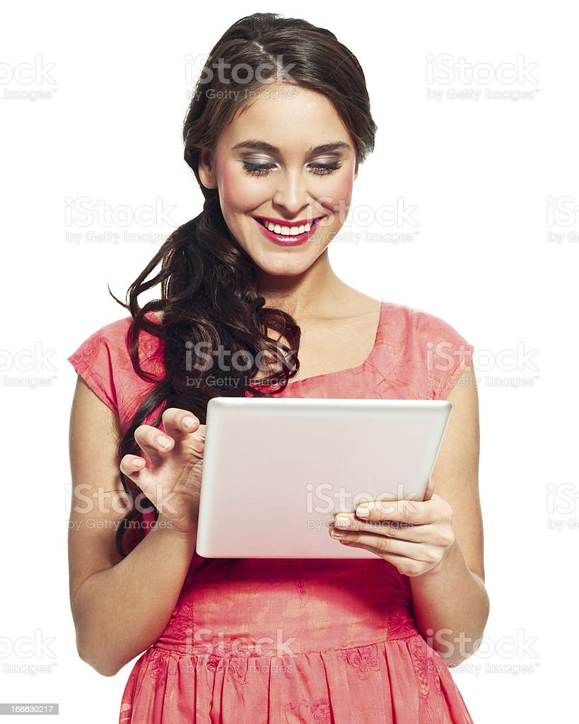 Woman with digital tablet Portrait of smiling young woman using a digital tablet. Isolated on white. 20-24 Years Stock Photo