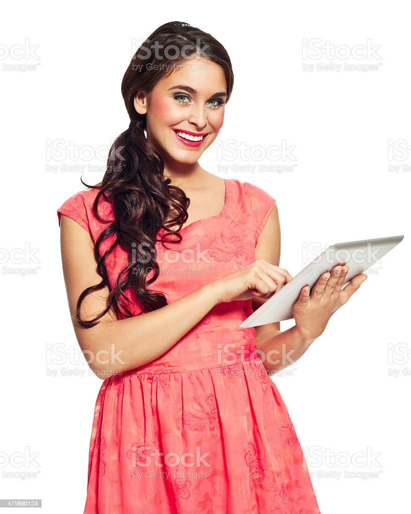 Woman with digital tablet Portrait of beautiful young woman using a digital tablet and smiling at the camera. Isolated on white. 20-24 Years Stock Photo