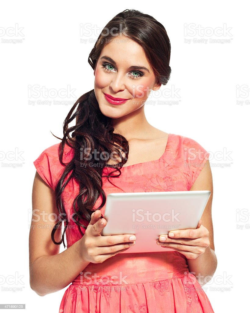 Woman with digital tablet Portrait of beautiful young woman holdig a digital tablet and smiling at the camer. Isolated on white. 20-24 Years Stock Photo