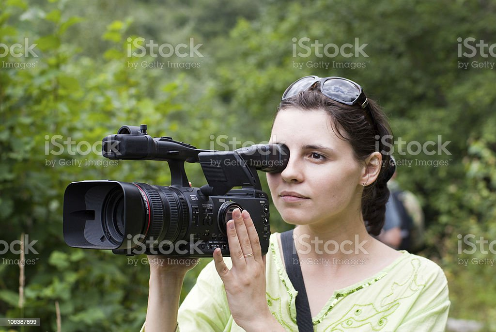 Woman with digital video camera. royalty-free stock photo