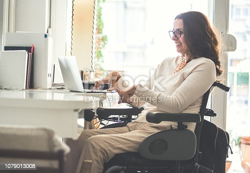 istock Woman with disability working 1079013008