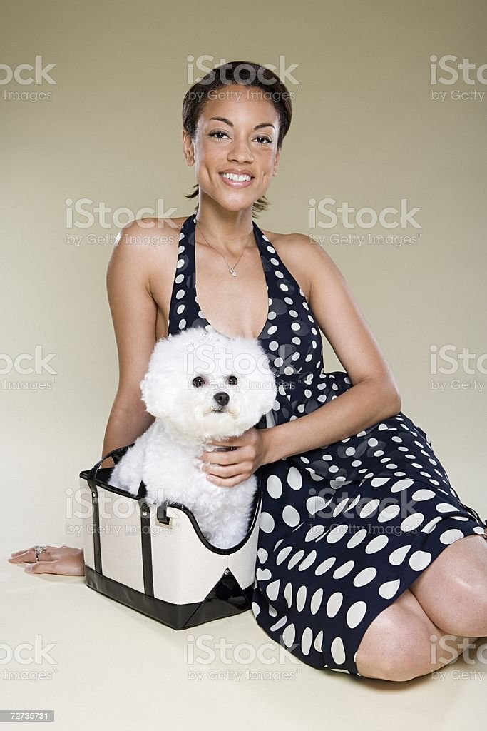 Woman with dog in a handbag