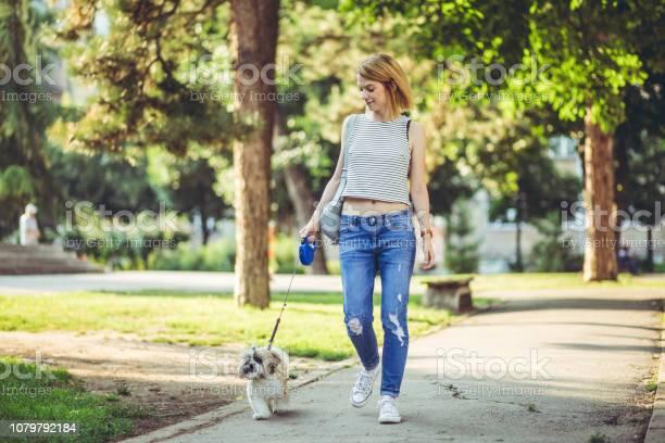 Woman with dog in a park picture id1079792184?b=1&k=6&m=1079792184&s=612x612&h=r3jb8fvnzqikgcse7n12nc3qwn1jvt1mxm40eus1trq=