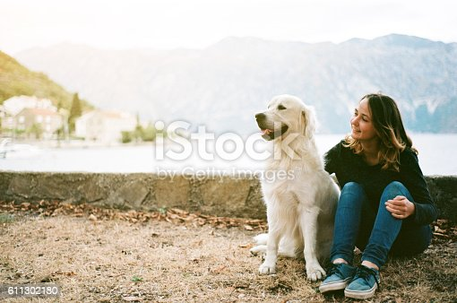 Woman with dog in camping near the Kotor Bay, Montenegro
