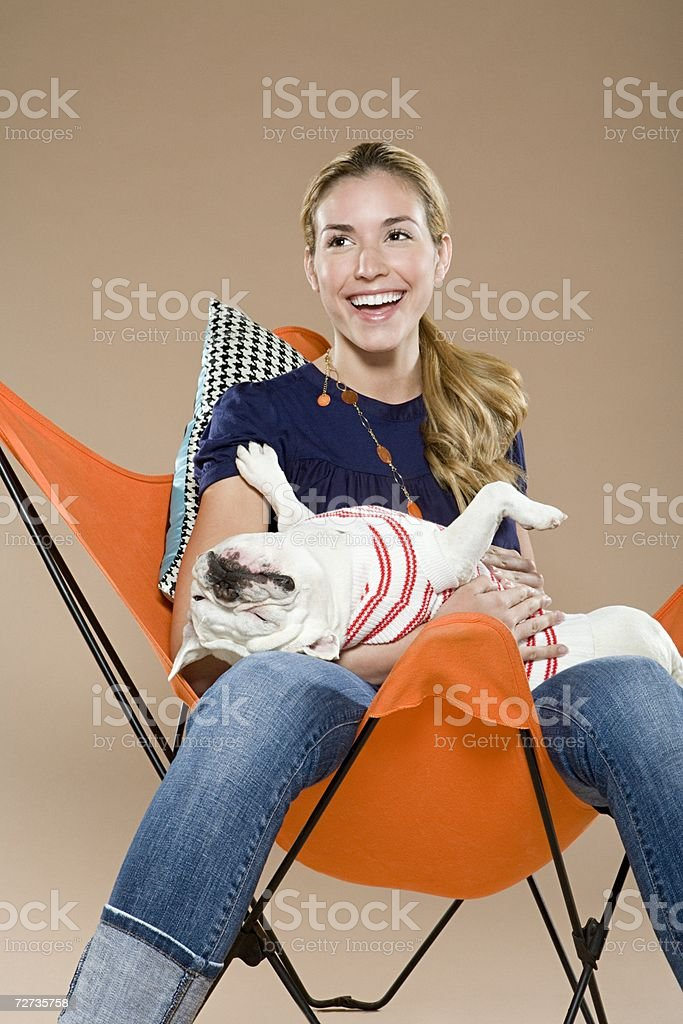 Woman with dog one her lap