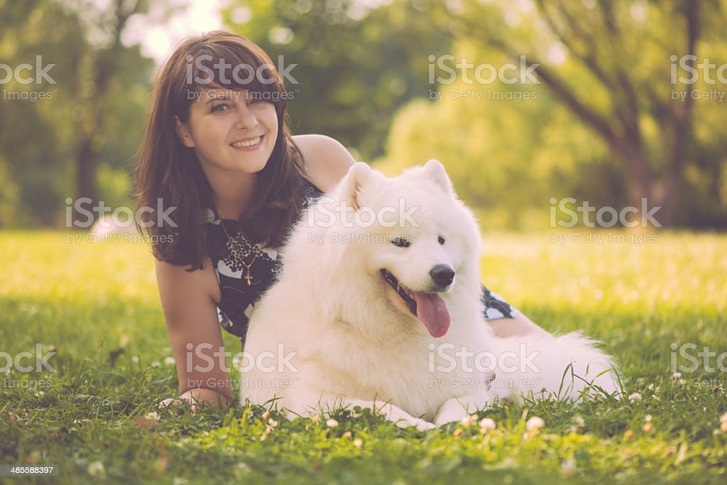 Beautiful woman with her samoyed dog