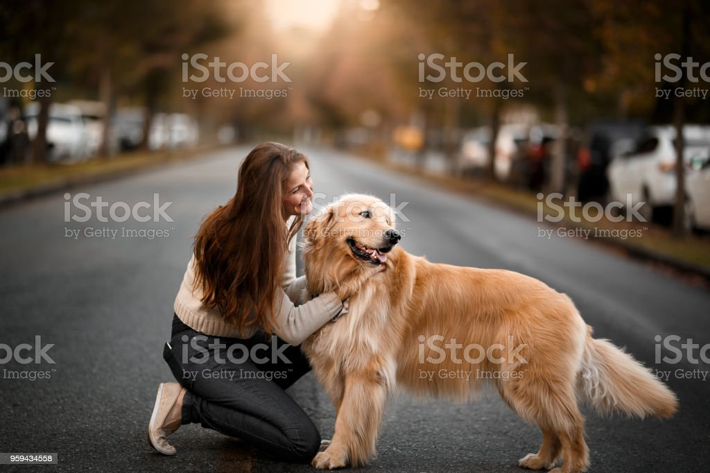 Woman with dog on the street
