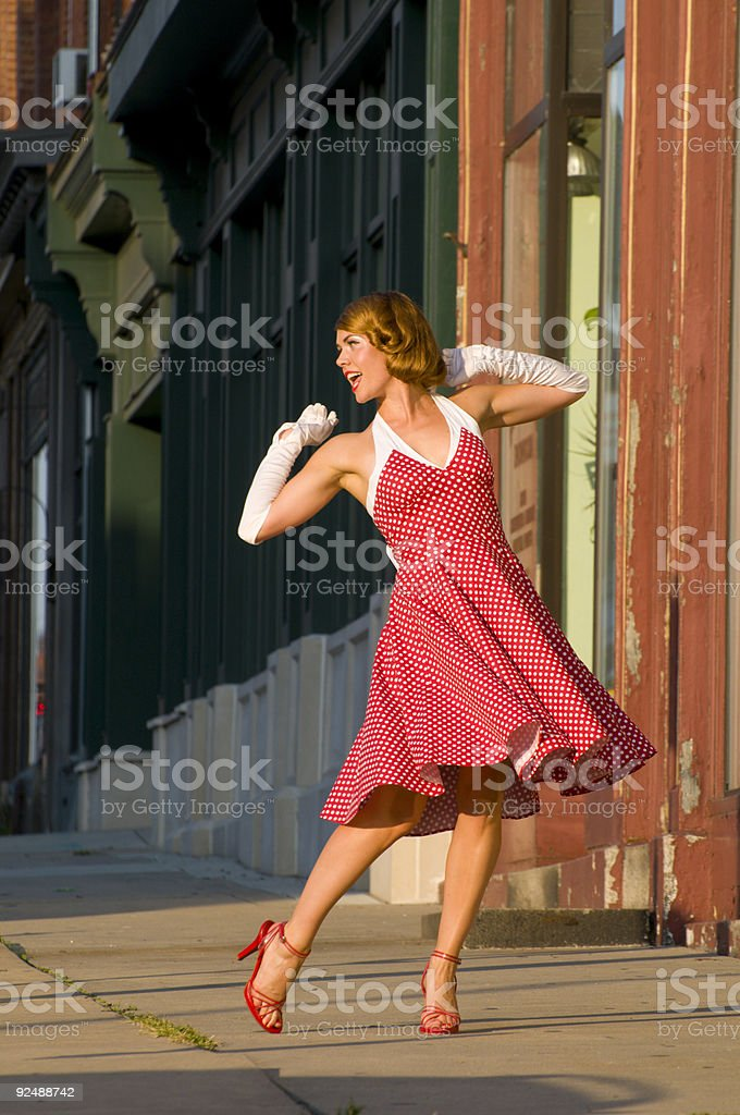 Woman with dress dancing happily in the street royalty-free stock photo